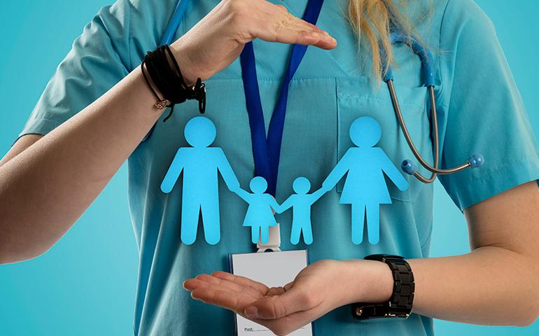 Image of a person holding cartoon graphics of a family.