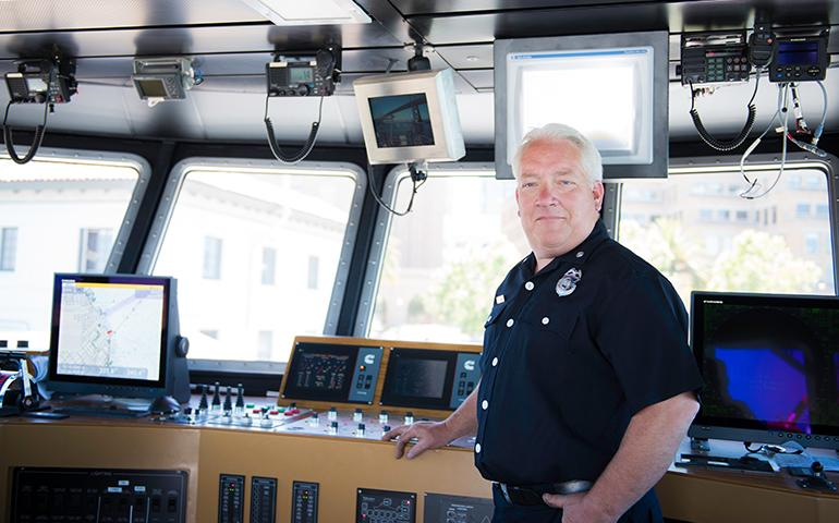 Image of Fireboat Engineer standing inside San Francisco Fire Department Fire Boat.