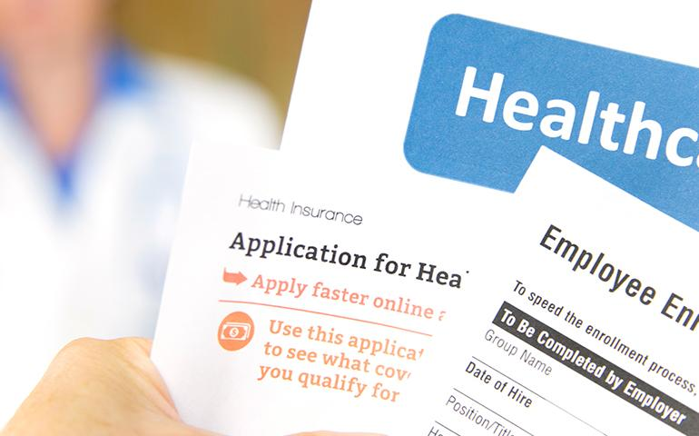 Image of several generic forms titled Healthcare Benefits enrollment.