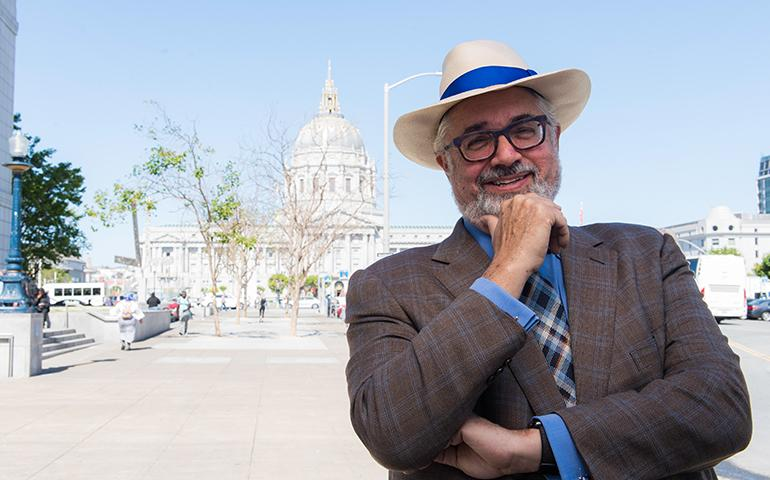 Image of retiree wearing hat in Civic Center with City Hall in the background.