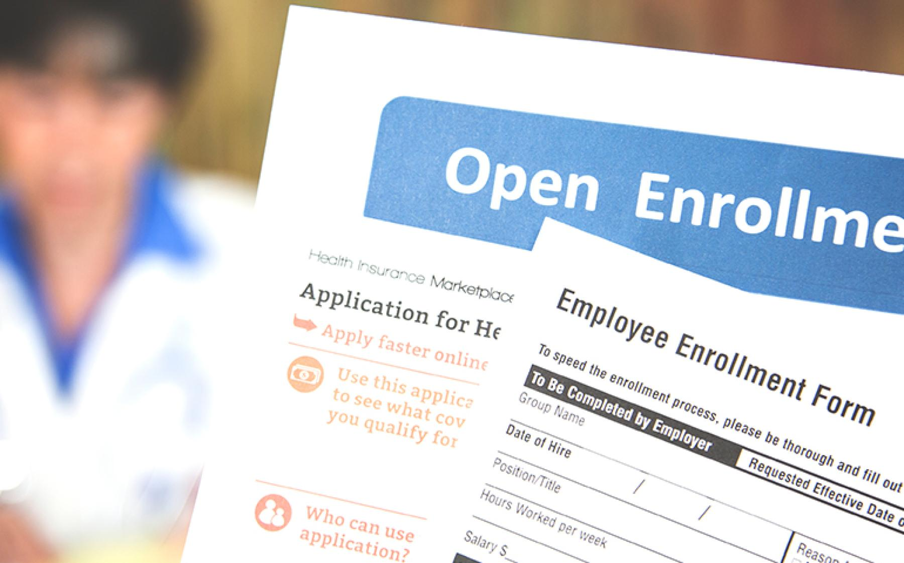 Image of open enrollment forms.
