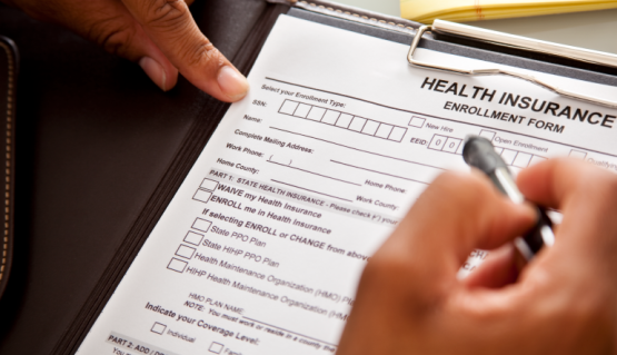 Photo of a person filling out a health form.